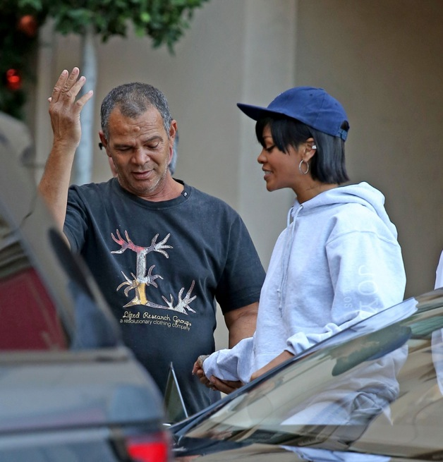 **EXCLUSIVE** Rihanna looks excited as she gets a surprise visit from her dad, Ronald Fenty, while leaving the Montage hotel with best friend Melissa