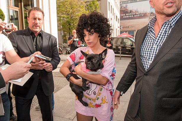 Lady-Gaga-arrives-with-her-Dog-Berlin-Germany