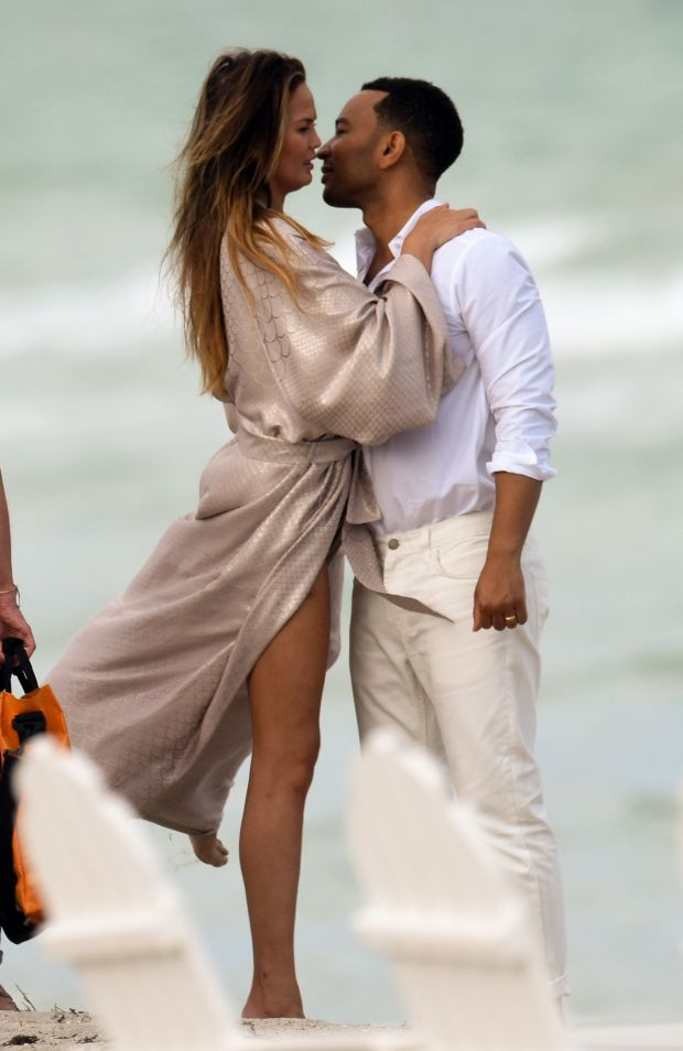 EXCLUSIVE: **PREMIUM RATES APPLY** INF - Chrissy Teigen gets naked during a photo shoot with her husband John Legend in Miami Beach.