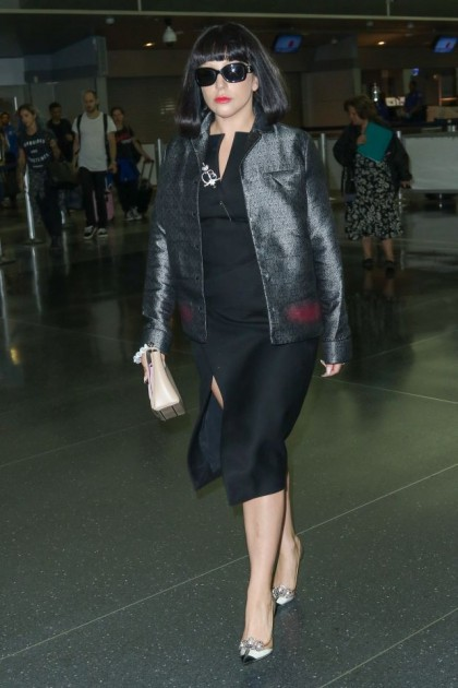 Lady Gaga is seen strolling through JFK Airport, showing off her engagement ring and outfit