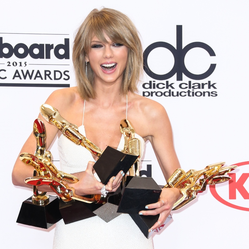 Taylor Swift poses in the press room with her eight Billboard Music Awards during the 2015 Billboard Music Awards