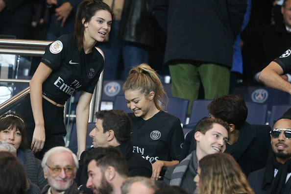 PARIS, FRANCE - OCTOBER 04:  Kendall Jenner and Gigi Hadid attends the French  Ligue 1 between Paris Saint-Germain and Olympique de Marseille at Parc Des Princes on October 4, 2015 in Paris, France.  (Photo by Xavier Laine/Getty Images)