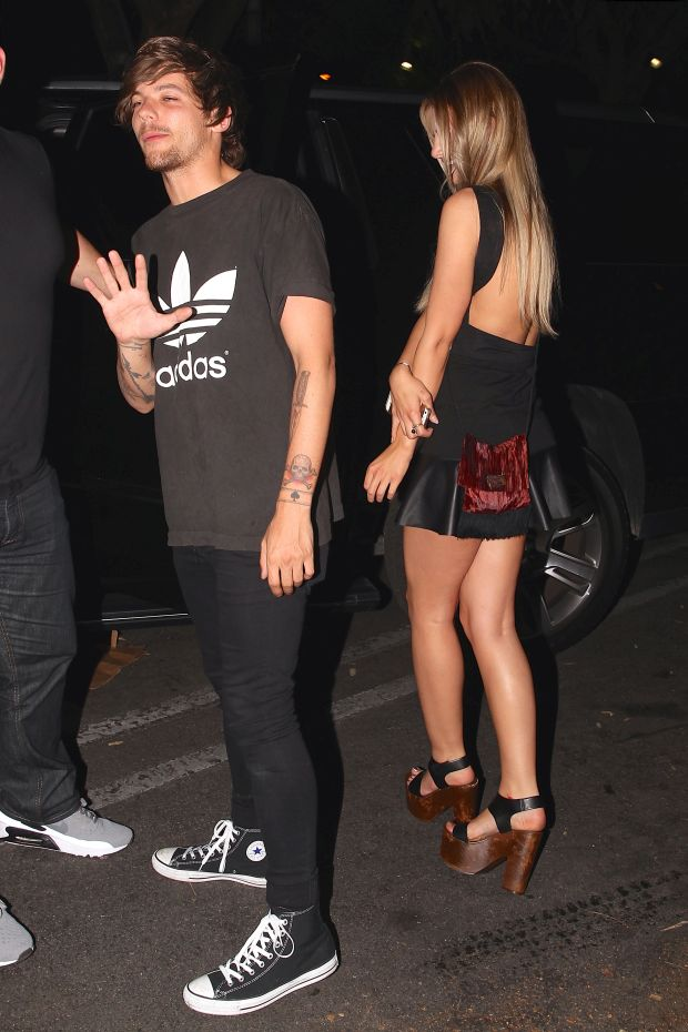 UK CLIENTS MUST CREDIT: AKM-GSI ONLY Louis Tomlinson and Briana Jungwirth enjoyed a late night out at Snoop Dogg's 'Bush' album release party held at DBA Nightclub. The One Direction star kept his look simple as he wore a black Adidas tee, skinny black jeans and a pair of Converse high tops.  He gave his thumbs up of approval before he loaded up into his awaiting limo. Pictured: Louis Tomlinson and Briana Jungwirth Ref: SPL1023637  110515   Picture by: AKM-GSI / Splash News